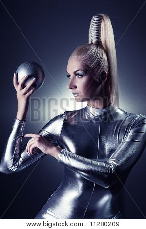 Beautiful blond cyber woman with a silver ball