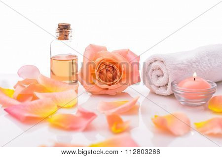 Orange rose ,petals and towel with petals