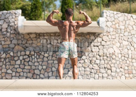 Physically Man Showing His Well Trained Back