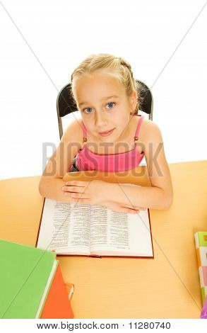 Little schoolgirl reading a book