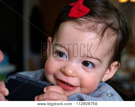 Toddler Girl Playing A Smartphone