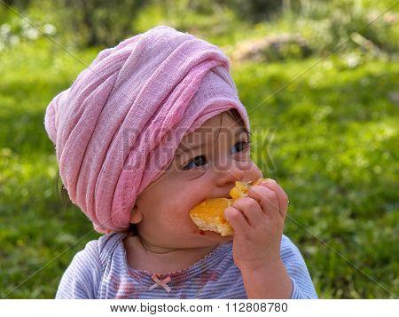 Cute Little Baby Girl Toddler Eating Orange Fruit