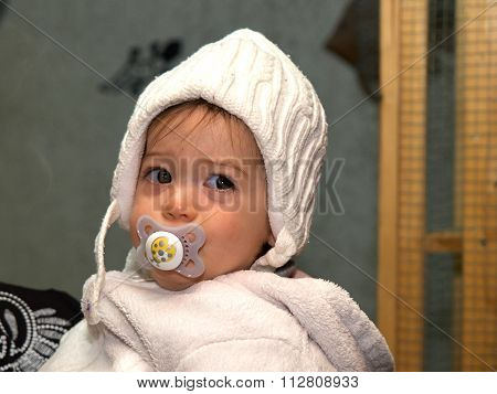 Toddler Baby Girl Using A Pacifier Dummy