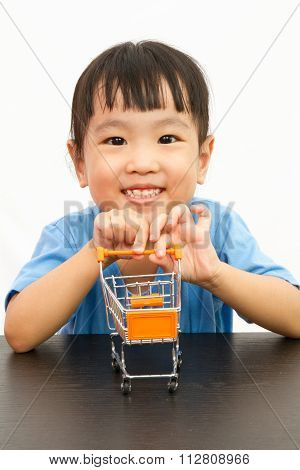 Chinese Little Girl Pushing A Toy Shopping Cart