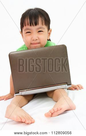 Chinese Little Girl Sitting On Floor With Laptop