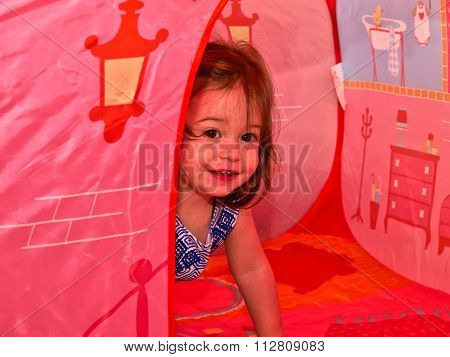 Happy Cute Toddler Girl Play In A Tent