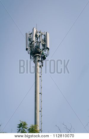 An Indian man working on Telecommunication tower.