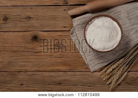 Flour In A Clay Bowl With Spikelets Of Wheat