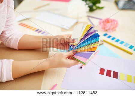 Close-up of interior designer choosing color