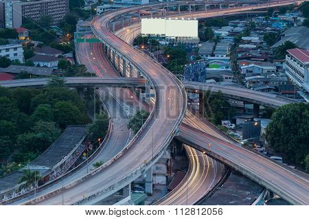 City interchange overpass at night in Bangkok