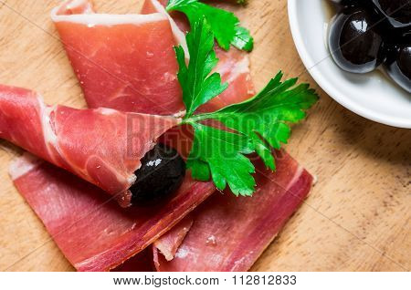 Jamon Serrano With Herbs And Olives For Tapas