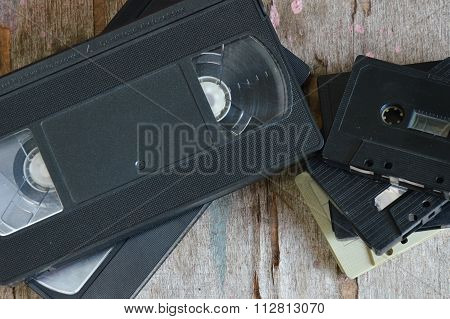 cassette tape and video tape recorder on wood board