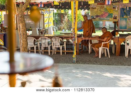 KOH CHANG - THAILAND - DEC 29, 2015: Unidentified local monks in the Wat Khlong Prao monastery on the island. Koh Chang one of the largest Islands of Thailand, located of 310 km from Bangkok.
