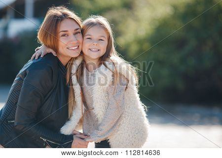 Portrait of young beautiful mom and daughter