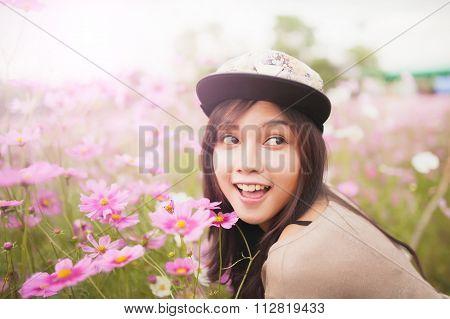 Beautiful Asian Women Smiling In Pink Cosmos Flower Field