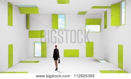 Businesswoman in room choosing one of plenty of doors