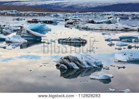 Icebergs and ice floes in the Ice Lagoon Jokulsarlon. South-east Iceland in July