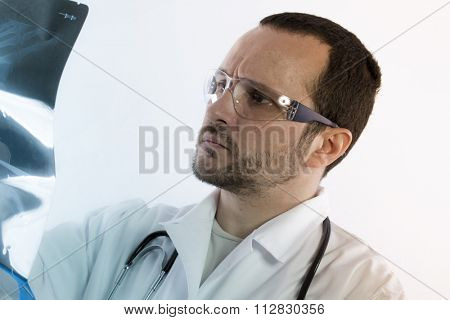 Radiologist looking at an x-ray in hospital