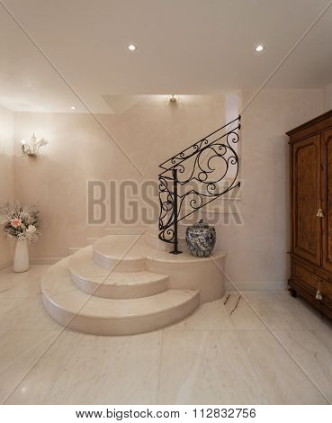 Hall of a luxury mansion, marble staircase