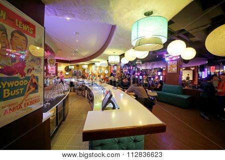 RUSSIAN, MOSCOW - JAN 18, 2015: People have a rest in Beverly Hills Diner restaurant.