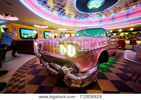RUSSIAN, MOSCOW - JAN 18, 2015: Beverly Hills Diner restaurant with pink Cadillac in the middle.