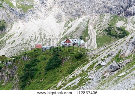 Alpine hut Prinz-Luitpold-Haus with rock face in the Alps