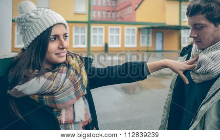 Woman rejecting with hand to man after quarrel
