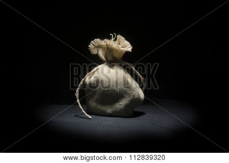 small bag jute on black background