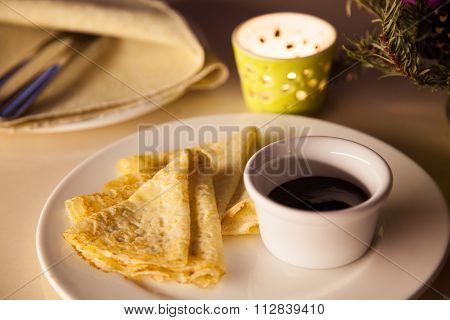 Crepes With Souse On A Plate