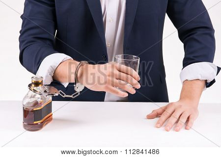 Man chained to alcoholic beverage.