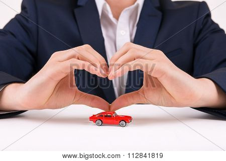 Man forming heart shape with his hands.
