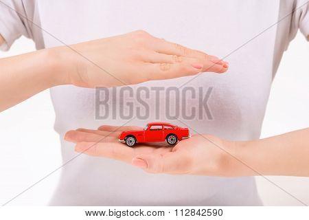 Woman holding little vintage car copy.