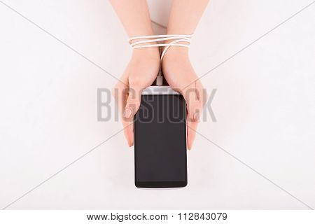 Female hands with smartphone.