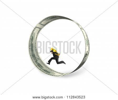 Businessman Carrying Dollar Sign Running In Circle Of Dollar Bills
