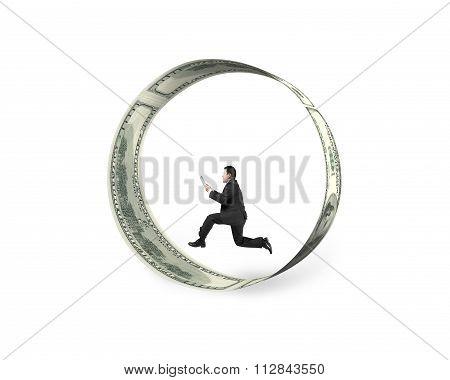 Businessman Holding Smart Tablet Running In Circle Of Dollar Bills