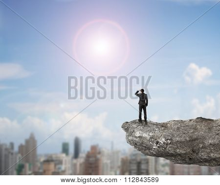 Rear View Businessman Standing Gazing On Cliff