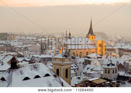 Winter snow Prague at sunset