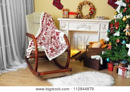 Living room with Christmas tree, fireplace and rocking chair