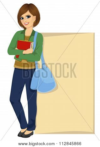 student leaning against a blank board
