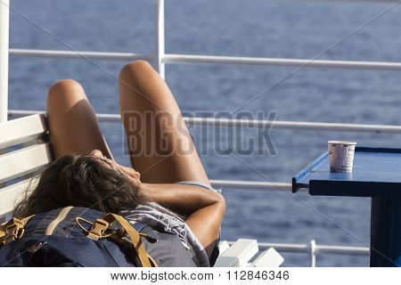 Passenger On Upper Deck Trying To Sleep Before Departure At Milos Island, Cyclades, Greece