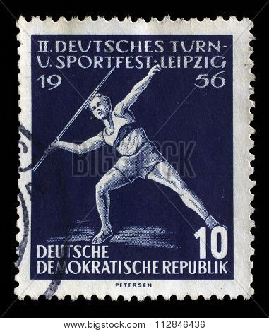 GDR - CIRCA 1956: a stamp printed in GDR shows javelin throwers, Second Sports Festival, Leipzig, circa 1956