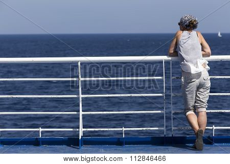 Passenger On Upper Enjoying The View While Waiting For Departure At Milos Island, Cyclades, Greece.