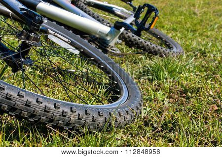 abstract bike on green grass meadow - soft photo
