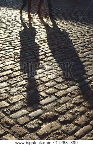 Shadows of couple walking