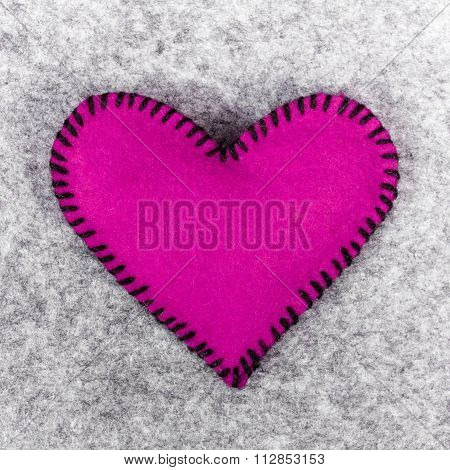 felt heart on a gray background