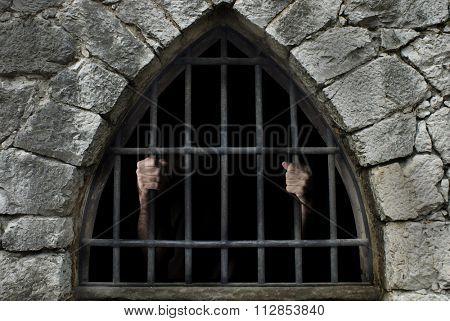 man beneath bars