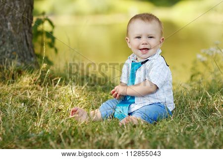 A Little Boy Playing Outdoors
