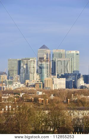LONDON, UK - DECEMBER 28: Detail of Canary Wharf's bank buildings with autumnal trees in the foreground. December 28, 2015 in London.