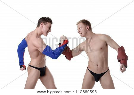 Confrontation of sexy guys dressed as superheroes