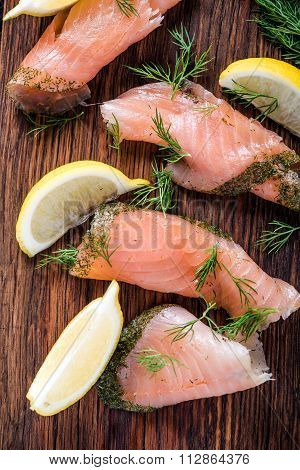 Smoked Salmon On Wooden Board With Dil And Lemon